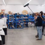 TV team films TORY - inventory robot from MetraLabs